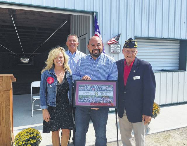 Committee Chairman Jack Powell with members Jen Woodland and Paul Butler were present at the dedication of the new Rosenberger Equine Center where they presented Ohio House Speaker Cliff Rosenberger with a commemorative plaque containing the pictures of all the local veterans who able to experience the Clinton County Honor Flights because of this program.