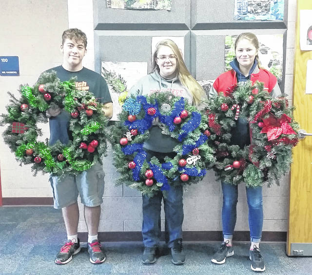 East Clinton High School Art students donated wreaths to the United Way of Clinton County's Annual Festival of Wreaths. Last year's donations were well-received and the students' participation was requested again. Ceramics students at ECHS created ceramic ornaments and decorated them with paint to add, along with other decorations and garland. Classes created three wreaths for this event. All proceeds from this event will help support more than 30 local programs here in Clinton County. The wreaths will be displayed at the United Way office, 100 West Main St., Wilmington, then available for purchase by silent auction Nov. 20 through the night of the HoliDazzle parade Nov. 25.