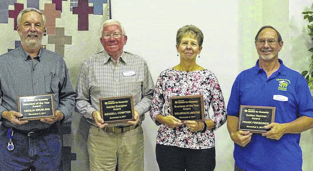 From left, Jim Krusling accepting award for his wife Cecilia Krusling, Wendell Compton, Diana Mason Jones and Frank Finkbeiner.