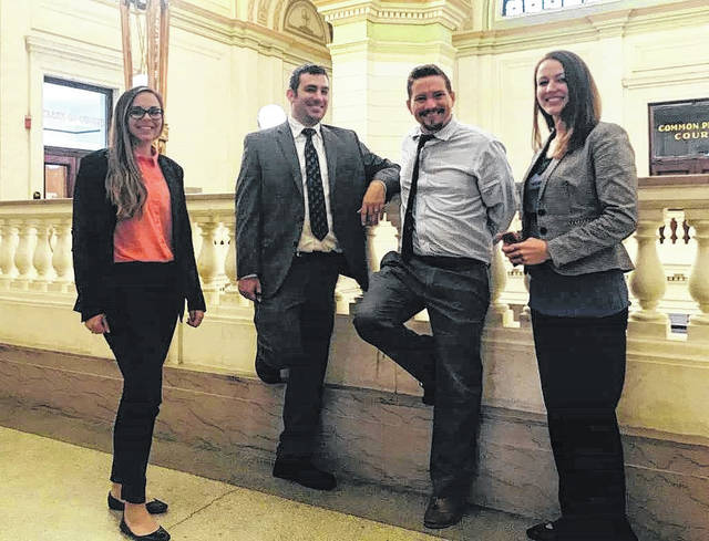 Clinic Administrator Jayme Mabry, volunteer attorneys Scott Evans and Brett Rudduck, and assistant prosecutor Katie Wright are shown in the Clinton County Courthouse after the October Family Law Clinic. Eighteen clients were assisted by the clinic in October.