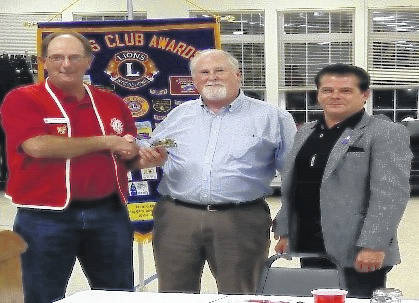 From left are Lion John Hibbs, 1st VP, with Dennis Mattingly and Jerome Adean.