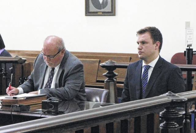 Seth Parshall, right, sits in court with defense attorney Bruce Wallace at a prior hearing in Highland County Common Pleas Court.