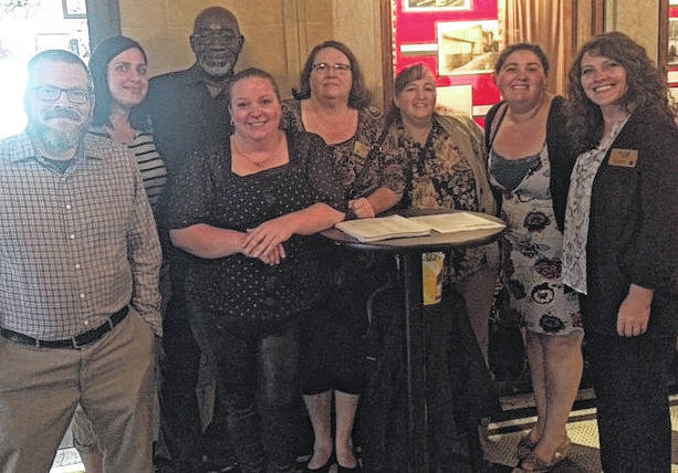 "From left are Peer Recovery Supporters Brett Duncan, Lynnette Graesser, Sheldon Greene and Stacy Litz, Clinical Supervisor Lori Grant, Peer Recovery Supporter Debra West, Program Coordinator Jenna Florence and Area Director Michelle Rolf. The group gathered for the documentary showing of ""The War We Ignore"" at The Murphy Theatre in Wilmington."