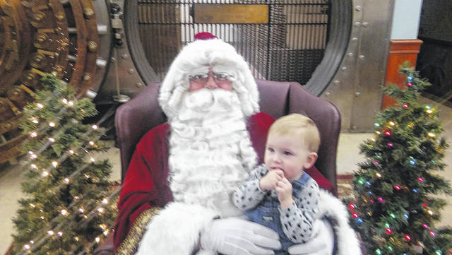 Owen Blue was about to tell Santa what he wants for Christmas when the reindeer took off in flight above them (inside Peoples Bank in downtown Wilmington)!