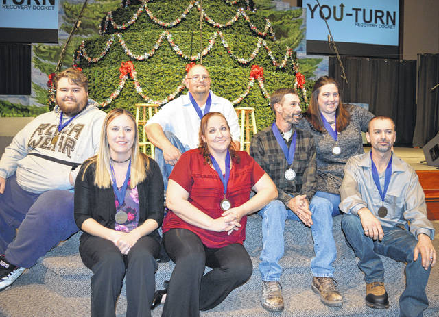 """The newest You-Turn Recovery Docket graduates are, from left, Jacob Odom, Tosha Salisbury, Jeremy Wallace, Stephanie Spencer, Maurice """"Todd"""" Estep, Racheal Roberts and Christopher Stanfield."""