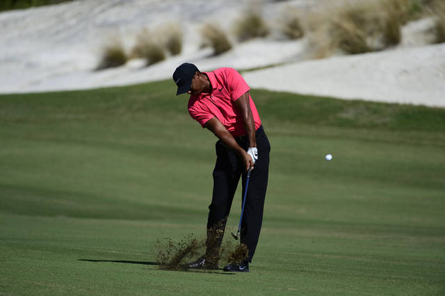 Tiger Woods hits from the first fairway during the final round of the Hero World Challenge golf tournament at Albany Golf Club in Nassau, Bahamas, Sunday, Dec. 3, 2017. (AP Photo/Dante Carrer)