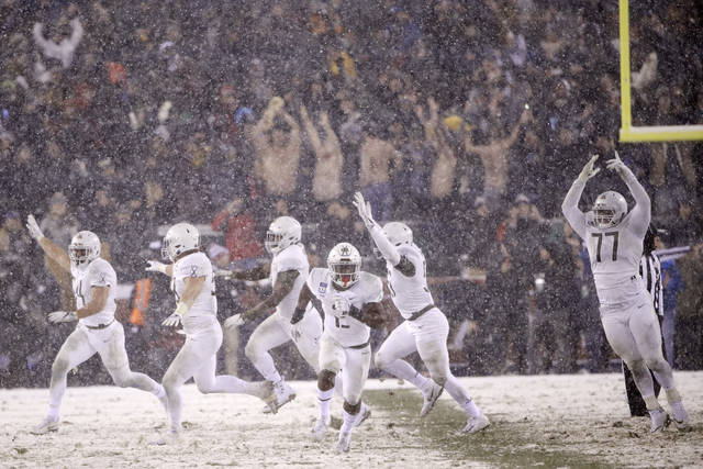 Army celebrates after defeating Navy in an NCAA college football game, Saturday, Dec. 9, 2017, in Philadelphia. Army won 14-13. (AP Photo/Matt Rourke)