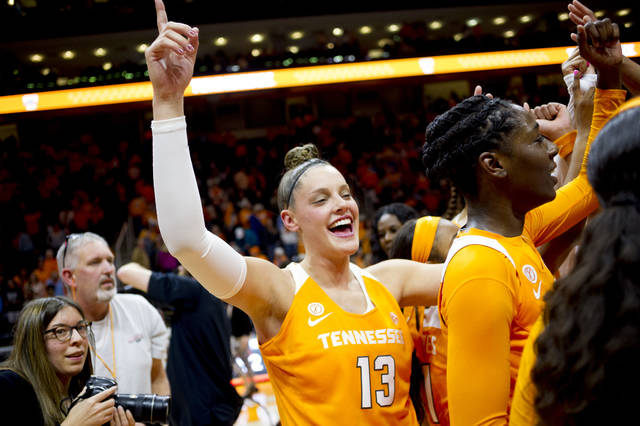 Tennessee forward Kortney Dunbar (13) celebrates after defeating Texas 82-75 in the second half of an NCAA college basketball game, Sunday, Dec. 10, 2017, in Knoxville, Tenn. (AP Photo/Calvin Mattheis)