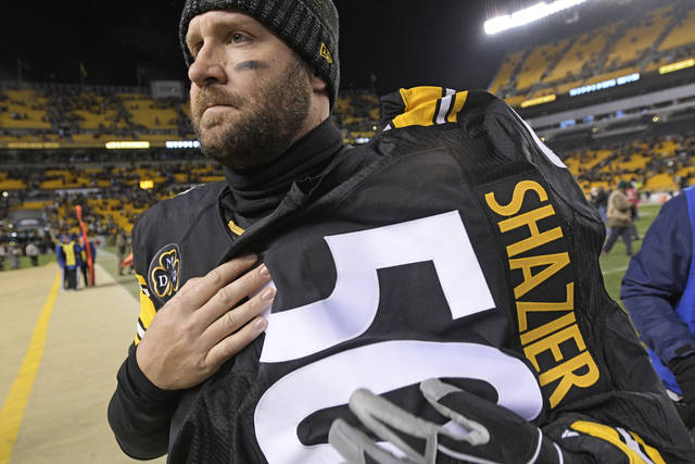 Pittsburgh Steelers quarterback Ben Roethlisberger (7) walks off the field holding the jersey of linebacker Ryan Shazier after beating the Baltimore Ravens 39-38 to clinch the AFC North Championship in an NFL football game in Pittsburgh, Monday, Dec. 11, 2017. Shazier suffered a spinal cord injury in last week's game and is recovering from surgery to stabilize his spine. (AP Photo/Don Wright)