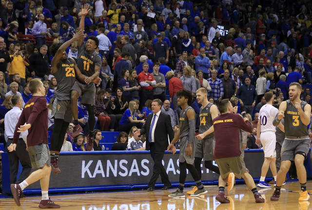 Arizona State forward Romello White (23) and guard Shannon Evans II (11) celebrate after an NCAA college basketball game against Kansas in Lawrence, Kan., Sunday, Dec. 10, 2017. Arizona State defeated Kansas 95-85. (AP Photo/Orlin Wagner)