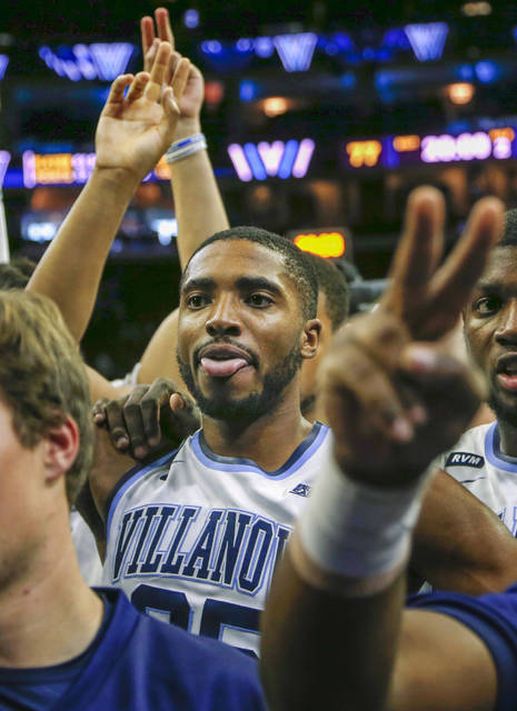 Villanova guard Mikal Bridges (25) center, waves to the crowd with his team after they defeated La Salle in an NCAA college basketball game, Sunday, Dec. 10, 2017, in Philadelphia. (AP Photo/Laurence Kesterson)