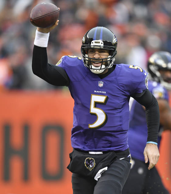 Baltimore Ravens quarterback Joe Flacco rushes for a 2-yard touchdown during the first half of an NFL football game against the Cleveland Browns, Sunday, Dec. 17, 2017, in Cleveland. (AP Photo/David Richard)