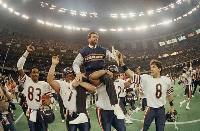 "FILE- In this Jan. 26, 1986, file photo, Chicago Bears head coach Mike Ditka is carried off the field by Steve McMichael, left, and William Perry after the Bears defeated the New England Patriots 46-10 in  Super Bowl XX in New Orleans. Argue all you want about which is the best team in NFL annals. The Pro Football Hall of Fame has opted for the 1985 Chicago Bears. The Canton shrine will premiere ""85: THE GREATEST TEAM IN FOOTBALL HISTORY"" on Jan. 3. It will then hit theaters nationwide on Jan. 29.  (AP Photo/Phil Sandlin, File)"
