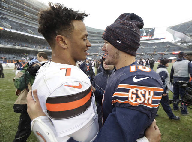 Cleveland Browns quarterback DeShone Kizer, left, and Chicago Bears quarterback Mitchell Trubisky (10) talk after an NFL football game in Chicago, Sunday, Dec. 24, 2017. Chicago won 20-3. (AP Photo/Charles Rex Arbogast)