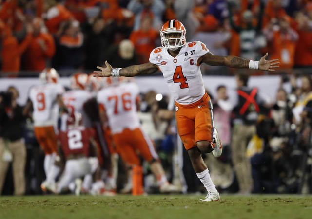 FILE - In this Jan. 10, 2017, file photo, Clemson's Deshaun Watson celebrates a last second game-winning touchdown pass to Hunter Renfrow in the second half of the NCAA college football playoff championship game against Alabama in Tampa, Fla. (AP Photo/John Bazemore)