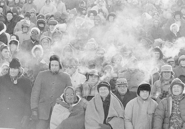 FILE - In this Dec. 31, 1967, file photo, fans watch the Green Bay Packers play the Dallas Cowboys in the NFL Championship game in Green Bay, Wisc. Simply dubbed the Ice Bowl, those who participated in Cowboys-Packers that day at Lambeau Field still shiver when talking about it. (AP Photo/File)