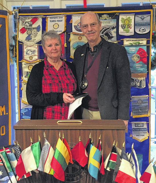 Sherri Lynn Stoops of Arms of Hope with AM rotary President Chuck Watts.