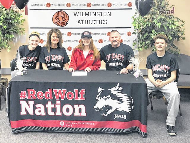 Wilmington High School senior Faith Sanderson signed with Indiana-East, an NAIA school, to play basketball next season. In the photo, from left to right, is Bailey Zerby, Michelle Zerby, Faith Sanderson, Pat Zerby, Ben Zerby.