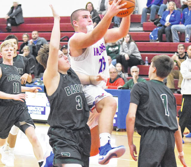 Trey Uetrecht had 14 points and 11 rebounds for Clinton-Massie against Badin.