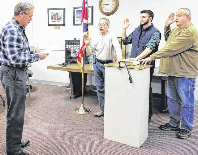 Blanchester Mayor John Carman, far left, swears in incoming Blanchester Village Council members. From right, Chad Hollon, Reilly Hopkins, and Gary Bauer. Not pictured: Lori Byrom.