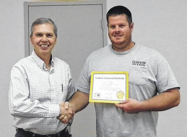 The New Vienna Lions Club recently inducted a new member into its organization during a brief ceremony in the town's community room. Brad Hughes, right, was welcomed by club members, which included sponsoring member Richard Hiatt, left. Brad Hughes is employed by the Clinton County Soil and Water Conservation District. He works to improve and preserve soil, water and natural resources within Clinton County. He resides just west of New Vienna and is a graduate of East Clinton High School. The New Vienna Lions Club is one of 46,000 local Lions Clubs operating in 210 countries. Each club has the goal of service to their local community and around the world.