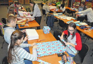 Wrapping to help others: WHS students, Rotary team up for kids