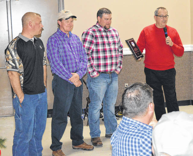 With a plaque honoring the Ag Society for the success of the NTPA Regional National Truck and Tractor Pull held at the fair is board member John Fankhauser (with the plaque) along with board members, from left, Kevin Garen, Mike Hacker and Josh Nickell.