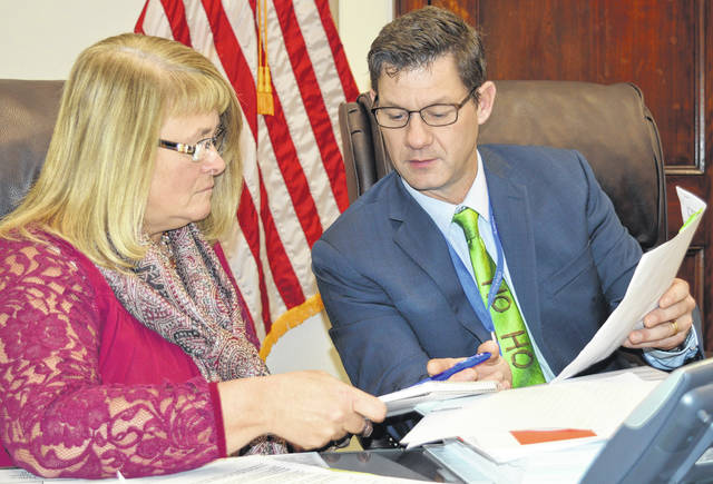 From left, Clinton County Commissioner Brenda K. Woods and Clinton County Commissioners President Kerry R. Steed prepare to vote on the county's 2018 General Fund budget.
