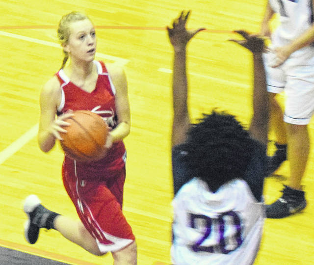 Paige Lilly (left) had nine points for East Clinton Thursday night against Waynesville.