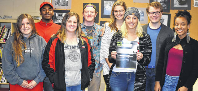 The staff of Wilmington College's newspaper The Witness with their most recent published release. From left are: front, Adriana Riccardi, Grace Barger, Editor Maraya Wahl and Aaliyah Compton; back, Brandon Williams, Sam Stanley, Hillary Mitchell and Layne Frederick. Not pictured are Savanna Burcham, Samantha O'Brien and Karmiela White.
