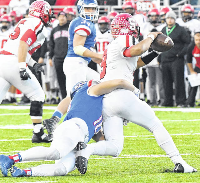 Clinton-Massie's Daulton Wolfe (10) had one of the few negative plays for Steubenville's Javon Davis in Saturday's OHSAA Division IV state championship game.