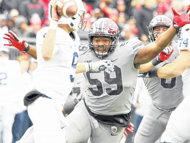 Tyquan Lewis was first-team All-Big Ten on the defensive line for Ohio State. The photo is from a game earlier this season against Penn State.