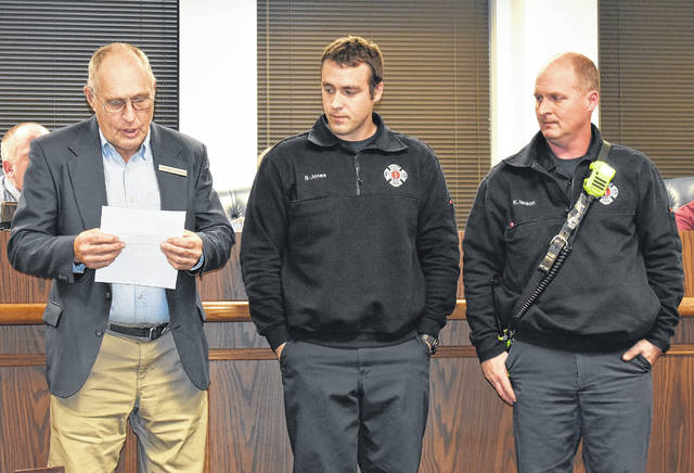 Wilmington firefighters William Jones, center, and Ken Ianson, right, were recognized by Mayor John Stanforth during Thursday's Wilmington City Council meeting after he received a letter praising the two during a carbon monoxide alarm at a residence on Thanksgiving eve.