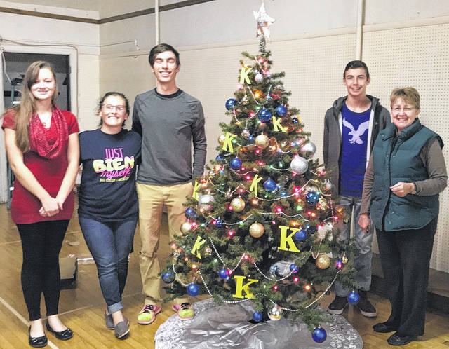 "The East Clinton High School Key Club decorated a tree for the ""Trees of Hope"" fundraiser this month for Hope House, a drop-in emergency shelter for women in Wilmington. From left are East Clinton Key Club members Jazmin Carrico, Marah Dunn, Ethan Harrington, Clayton Harrington and East Clinton Key Club Advisor Jackie Walker. The Wilmington Kiwanis Club sponsors the youth group."