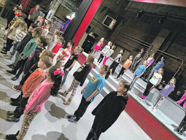 The many Murphy Kids await instruction from director Timothy Larrick during rehearsal for the Murphy Theatre Annual Christmas Show, which returns at 7:30 p.m. Dec. 8-9; and at 2 p.m. Dec. 9-10. The show features local performers of all ages who will delight audiences and usher in Christmas magic. For more information visit www.themurphytheatre.org.