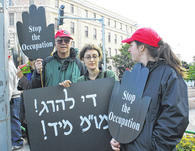 Neil Snarr of Wilmington in Jerusalem with the Women in Black — Jewish women protesting the occupation of Palestine by Israel — and held a placard supporting human rights for Palestinians.