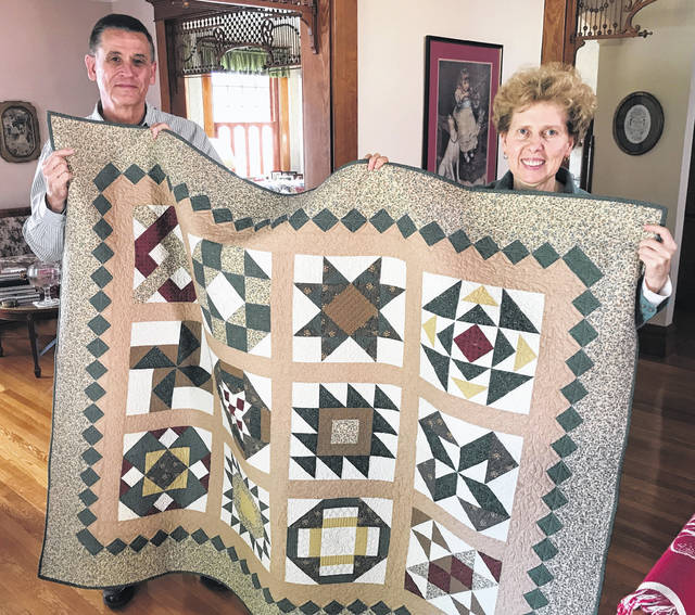 The winner of the Clinton County Humane Society's recent quilt raffle was Angela Earley, pictured with her husband, Jeff, receiving the quilt after the drawing in November. For the shelter fundraiser, Georgann Quallen quilted and donated the 58-by-70-inch Pioneer Sampler, which had been on display at the Cotton Junky in downtown Wilmington. The nonprofit Clinton County Humane Society, located at 1760 Fife Ave., has adopted more than 7,300 animals since it was formed in 2003. The funds raised will help the shelter spay, neuter, and vaccinate the animals in its care.