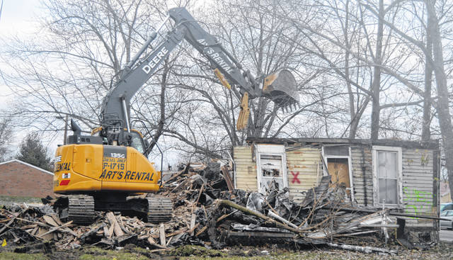 In Wilmington a corner house at the intersection of South Wall Street and Dr. Martin Luther King Jr. Way (aka Elm Street) is knocked down recently as part of the Clinton County Land Bank's efforts to remove and green vacant and blighted properties.