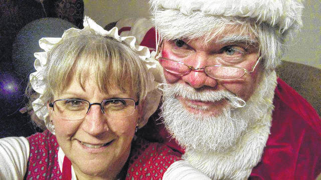 From left, Terri and Bruce Stauffer will be Mr. and Mrs. Santa Claus for the New Vienna Vintage Christmas event Saturday at the Snow Hill Country Club.