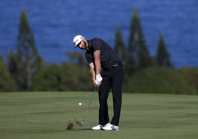 FILE - In this Jan. 7, 2017, file photo, Dustin Johnson hits from the fourth fairway during the third round of the Tournament of Champions golf event at Kapalua Plantation Course in Kapalua, Hawaii. Johnson is No. 1 in the world, a 33-year-old entering his prime who won four times last year. The Tournament of Champions, beginning Thursday, Jan . 4, 2018, is reserved only for those who did something special last year _ win on the PGA Tour. (AP Photo/Matt York, File)
