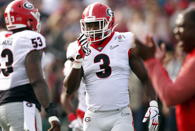 FILE - In this Monday, Jan. 1, 2018, file photo, Georgia linebacker Roquan Smith (3) during warm ups before the start Rose Bowl NCAA college football game against Oklahoma in Pasadena, Calif. A case can be made that Smith has been the best defensive player in the country this season. He is an instinctive linebacker and Georgia will move him around in the tackle box to free him to run to the ball. (Joshua L. Jones/Athens Banner-Herald via AP)