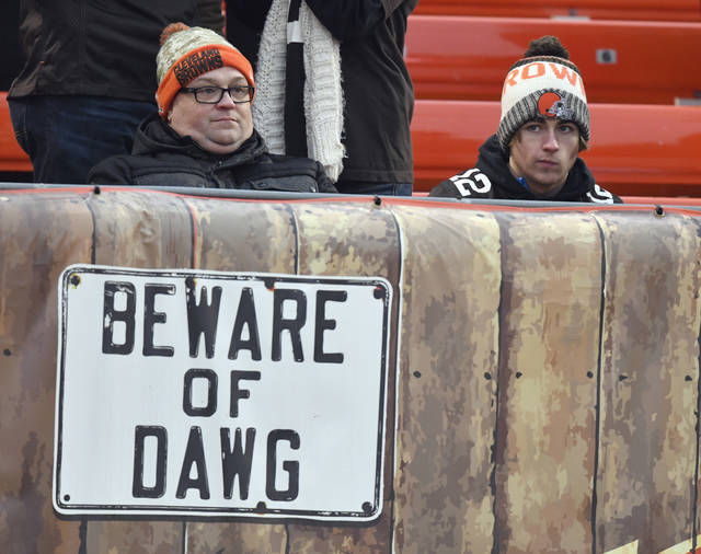 FILE - In this Sunday, Dec. 17, 2017, file photo, Cleveland Browns fans react during the second half of 27-10 loss to the Baltimore Ravens in an NFL football game in Cleveland. Baltimore won. Despite temperatures forecast in the single digits, hundreds,  and perhaps thousands, of disillusioned fans are expected to attend a protest parade on Saturday to commemorate Cleveland's historically inept 0-16 season.  (AP Photo/David Richard, File)
