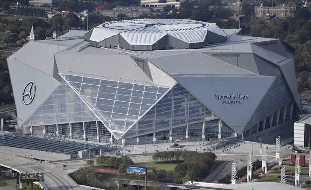 FILE - This Nov. 1, 2017, file photo shows the Mercedes-Benz stadium in Atlanta. Atlanta's new $1.5 billion stadium is about to be on perhaps its largest national stage for the Monday, Jan. 8, 2018, College Football Playoff title game, fans say the glitzy facility is living up to the hype despite a series of construction setbacks that delayed its opening. (AP Photo/Mike Stewart, File)