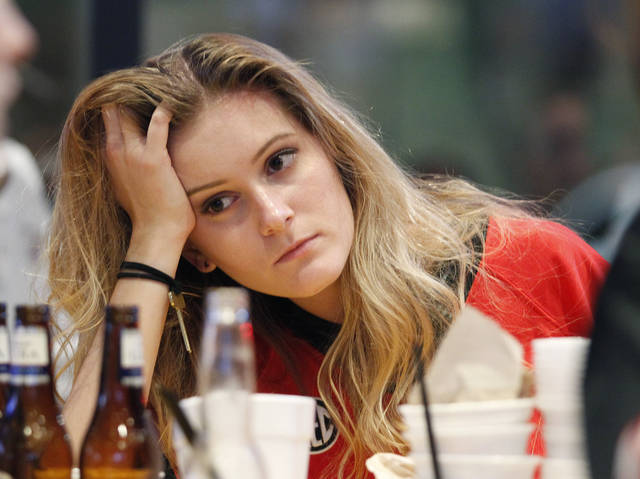 Georgia fans Anna Wilson reacts to Georgia's loss while watching the College Football Playoff national championship football game against Alabama in Athens, Ga., Monday, Jan. 8, 2018. Alabama won, 26-23. (AP Photo/Tami Chappell)