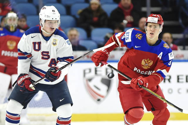 FILE - In this Tuesday, Jan. 2, 2018 file photo, United States forward Casey Mittelstadt (11) and Russia forward Mikhail Maltsev (13) vie for the puck during the first period of a quarterfinal in the IIHF world junior hockey championships in Buffalo, N.Y. A funny thing happened when the offensively challenged Sabres left town for two weeks to make way for the world junior hockey championship. Buffalo's win-starved hockey fans got a glimpse of a far more promising future in the likes of Casey Mittelstadt. (Nathan Denette/The Canadian Press via AP, File)