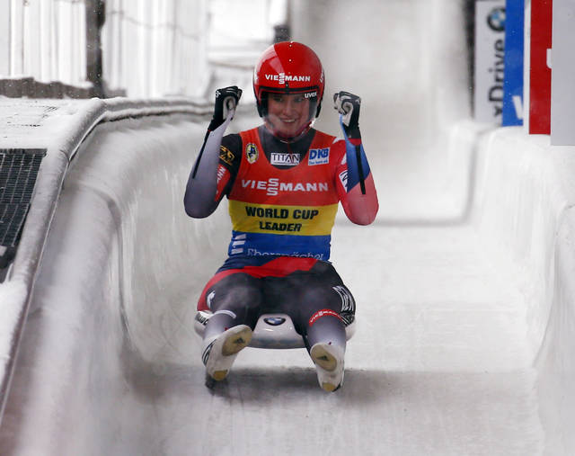 FILE - In this Dec. 16, 2017, file photo, Natalie Geisenberger, of German, celebrates after placing first in a World Cup luge event in Lake Placid, N.Y. There's some sort of mystical power when it comes to Germany and luge. Germany has more sliding tracks than any other nation, plus always seems to be ahead of the rest of the world when it comes to technology and any other innovation that can be used to get a sled down the ice faster than anyone else. (AP Photo/Peter Morgan, File)