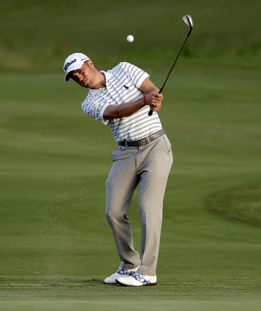 Defending champion Justin Thomas chips onto the 18th green during the first round of the Tournament of Champions golf event, Thursday, Jan. 4, 2018, at Kapalua Plantation Course in Kapalua, Hawaii. (AP Photo/Matt York)