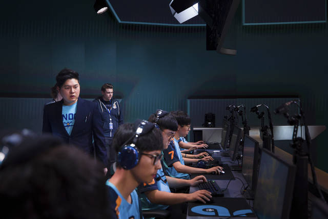 In this Dec. 7, 2017 photo provided by Blizzard Entertainment several members of the London Spitfire esports team compete in a preseason match in the Overwatch League at Blizzard Arena in Burbank, Calif. The new Overwatch League is a well-funded attempt to combine cutting-edge esports competition with a traditional sports league structure. (Robert Paul/Blizzard Entertainment via AP)