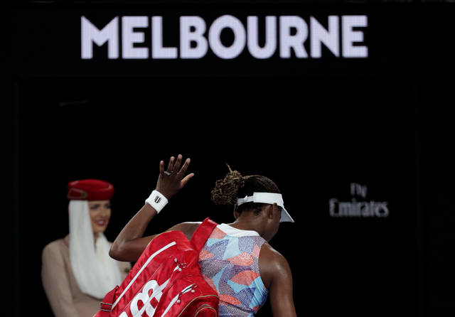 United States' Venus Williams leaves Rod Laver Arena following her first round loss to Switzerland's Belinda Bencic at the Australian Open tennis championships in Melbourne, Australia, Monday, Jan. 15, 2018. (AP Photo/Vincent Thian)