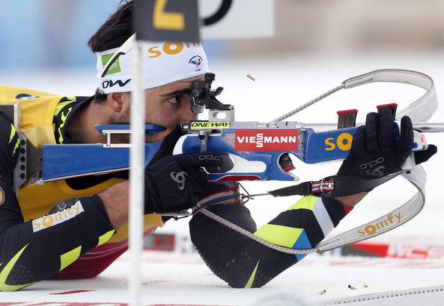 FILE - In this Dec. 19, 2014, file photo, France's Martin Fourcade shoots during the men's 10-km sprint competition at the biathlon world cup in Pokljuka, Slovenia, Friday, The 29-year-old Fourcade has been the sport's most dominant competitor since the 2011-12 season when he won the first of six straight World Cup total score championships. He's considered a favorite to take home gold in South Korea. (AP Photo/Darko Bandic, File)